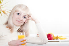 Beautiful woman has a breakfast Royalty Free Stock Images