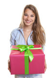 Beautiful woman has a colorful gift Stock Image