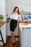 The beautiful woman has made cake in kitchen Royalty Free Stock Image