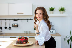 The beautiful woman has made cake in kitchen Stock Photos