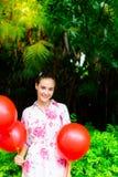 Beautiful woman has party in beautiful park. Charming beautiful stock image