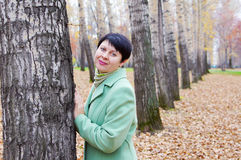 Beautiful woman has a rest in autumn park Royalty Free Stock Photography