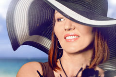 Beautiful woman in a hat Stock Photography