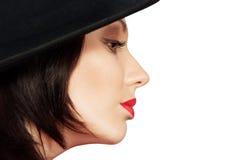 Beautiful woman in hat Stock Photos