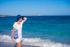 Beautiful woman in hat and bag at white sand Stock Photography