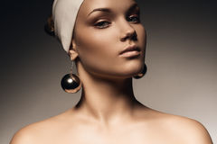 Beautiful woman in hat with big earrings Stock Images