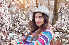 Beautiful woman in a hat in the blossoming spring garden Royalty Free Stock Photography