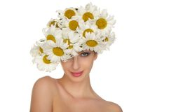 Beautiful woman in the hat of daisies Stock Images