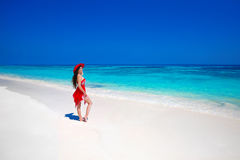 Beautiful woman in hat enjoying summer vacation on exotic beach Royalty Free Stock Photos