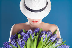 Beautiful woman in hat with flowers Royalty Free Stock Photo
