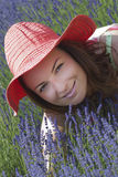 Beautiful woman with hat in a lavender field Royalty Free Stock Photo