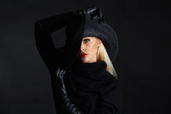 Beautiful woman in hat and leather gloves. Retro fashion model girl.halloween witch Royalty Free Stock Image