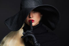 Beautiful woman in hat and leather gloves. Retro fashion model girl.halloween witch Stock Images