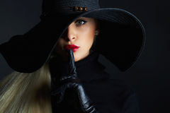 Beautiful woman in hat and leather gloves. Retro fashion model girl.halloween witch. Beautiful woman in hat and leather gloves. Retro fashion model girl.black Royalty Free Stock Photos