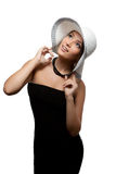 Beautiful woman in a hat looks up Stock Photography