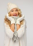 Beautiful woman in hat, muffler and mittens Stock Photos