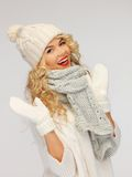 Beautiful woman in hat, muffler and mittens Royalty Free Stock Image