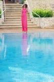 Beautiful woman in hat near pool Stock Photo