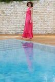 Beautiful woman in hat near pool Royalty Free Stock Image