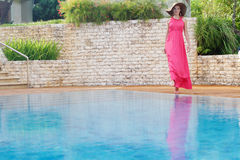 Beautiful woman in hat near pool Royalty Free Stock Photos