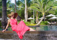 Beautiful woman in hat near pool Stock Image