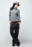 Beautiful woman in a hat and pants Royalty Free Stock Photos