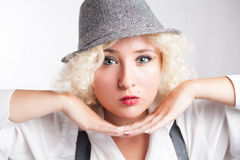 Beautiful woman in hat with red lips, business style. Stock Image