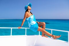 Beautiful woman in hat relaxing on the yacht Stock Photos