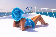 Beautiful woman in hat relaxing on the yacht Royalty Free Stock Photography