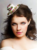 Beautiful woman in hat with roses Stock Image