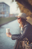 Beautiful woman in hat and scarf with cup of coffee Stock Photo
