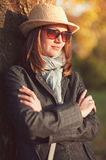 Beautiful woman in hat and scarf enjoy sunlight Stock Photography