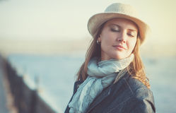 Beautiful woman in hat and scarf Royalty Free Stock Photos