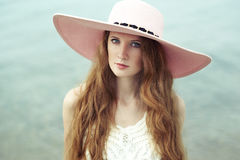 Beautiful woman in hat on the sea Stock Photos