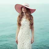 Beautiful woman in hat on the sea Royalty Free Stock Image