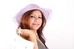 Beautiful woman in hat shopping Stock Image