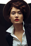Beautiful woman. With hat in studio Royalty Free Stock Photos