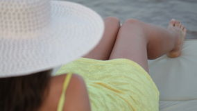 Beautiful woman with hat sunbathing lounger on the beach.  stock video
