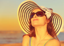 Beautiful woman in hat and sunglasses enjoying Stock Images