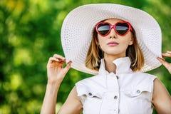 Beautiful woman hat sunglasses Stock Image