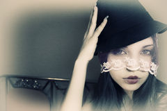 Beautiful woman in a hat and a veil Royalty Free Stock Image