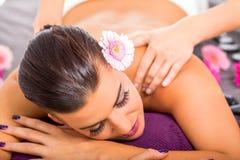 Beautiful woman having a back massage Royalty Free Stock Photo