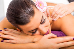Beautiful woman having a back massage Royalty Free Stock Photography