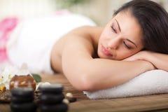 Beautiful woman having beauty treatments in the spa salon stock image