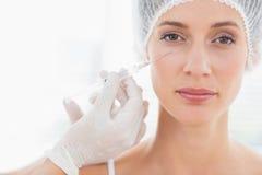 Beautiful woman having botox injection Stock Photos