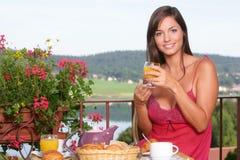 Beautiful woman having breakfast Royalty Free Stock Photos