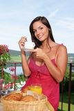 Beautiful woman having breakfast Royalty Free Stock Photo