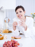 Beautiful woman having breakfast Stock Image