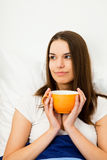 Beautiful Woman Having Coffee In Bed Stock Photography