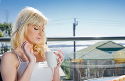 Beautiful woman having coffee in cafe Royalty Free Stock Photo